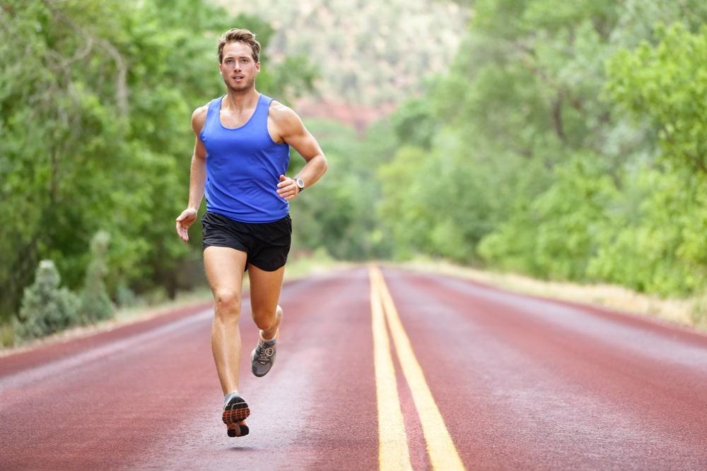 man running along a highway