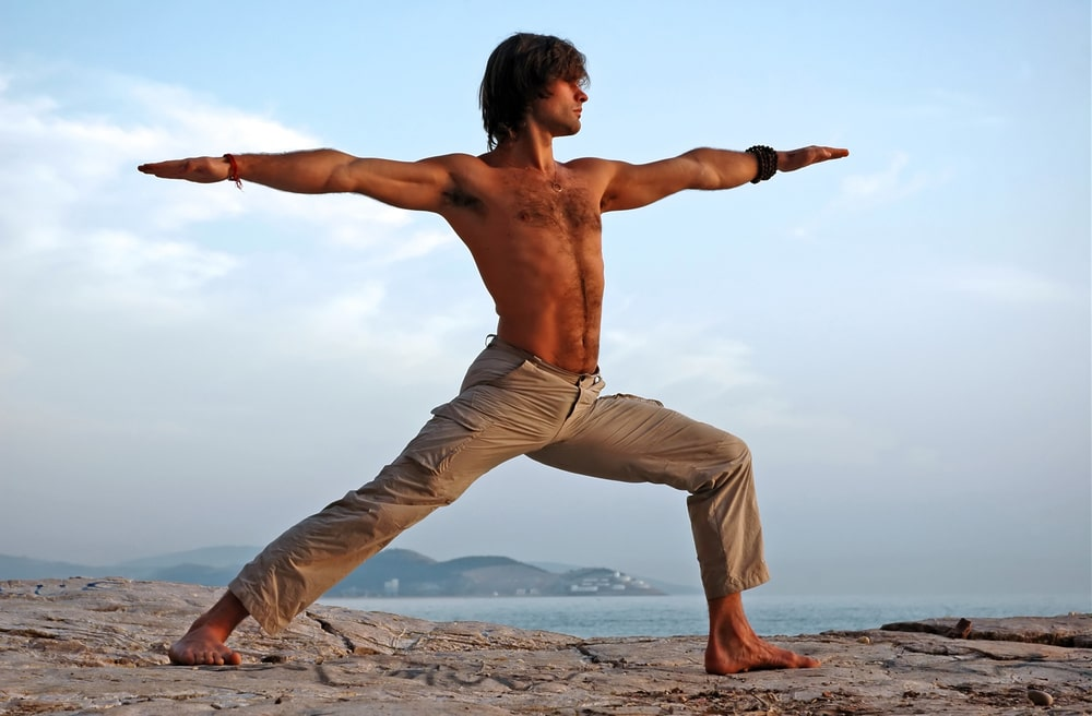 Man performing a yoga pose - warrior II