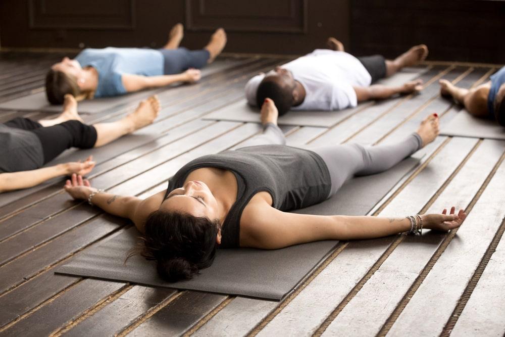 Yoga group in Savasana or Corpse Pose