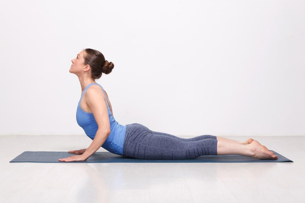 Woman performing Cobra pose