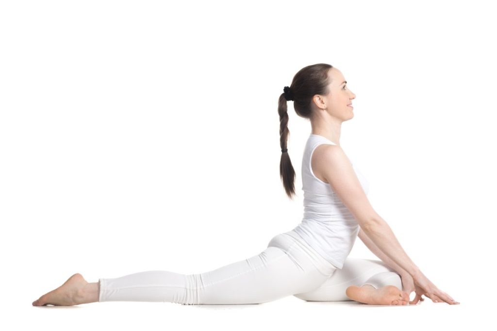 Half pigeon pose for hip stretches
