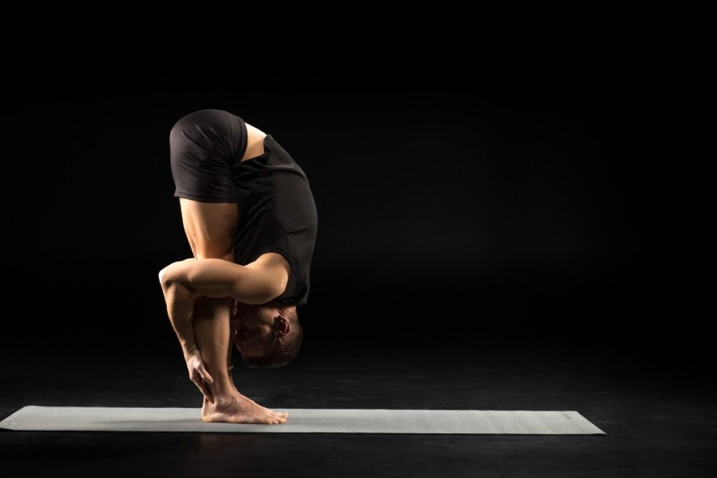 Standing forward bend for hamstring and back flexibility